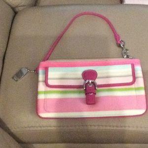Coach wristlet pink,blue and green dark pink strap